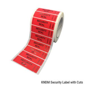 kndm-security-label-with-cuts-reel